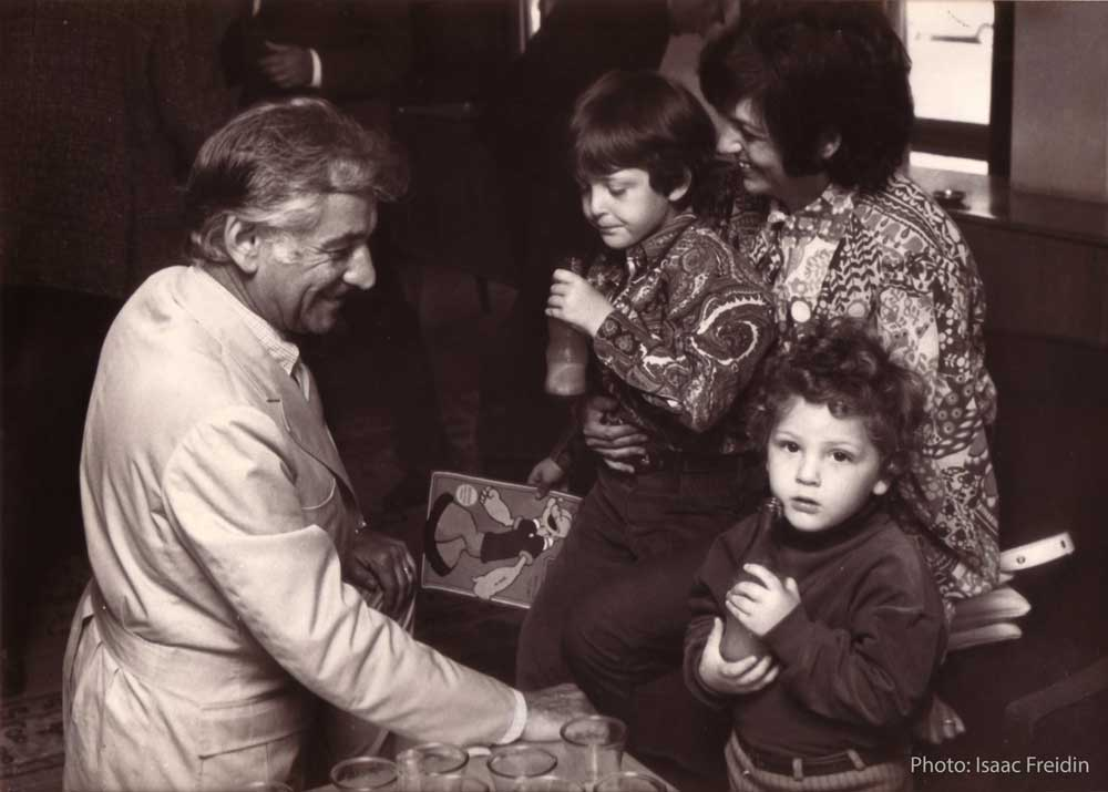 Ady Cohen, age 6, on his pianist mother Ruth Menze's lap, his brother Sharon and his future patron, Maestro Leonard Bernstein